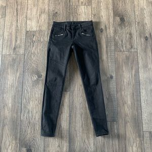 Black skinny jeans with zipper accents